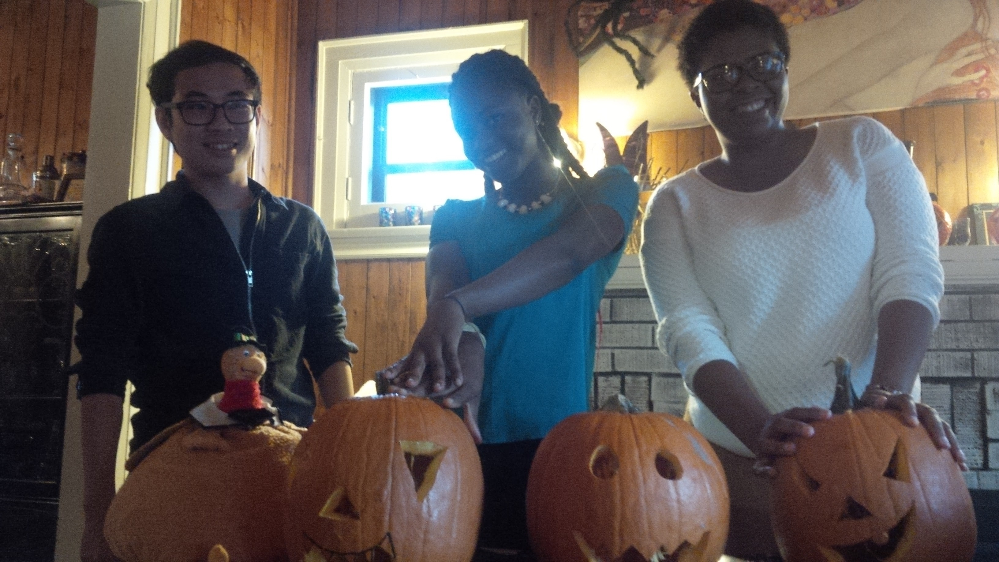 Students showing off their carved pumpkins