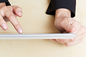 Person interacting with tablet