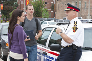 Students talking to a police officer