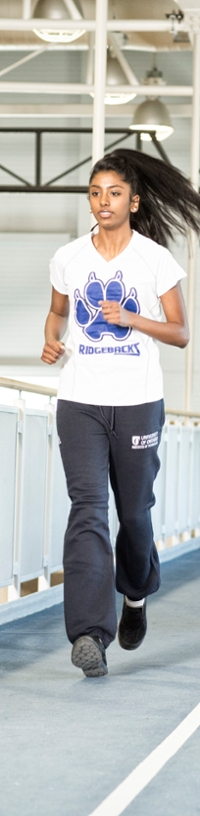 Student running on the CRWC indoor track