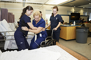 Professor teaching a nursing student