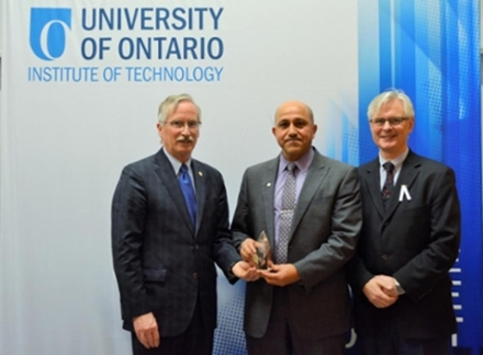 Dr. Gaber receiving Research Excellence Award