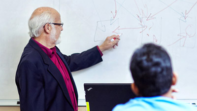 Faculty member teaching in a classroom