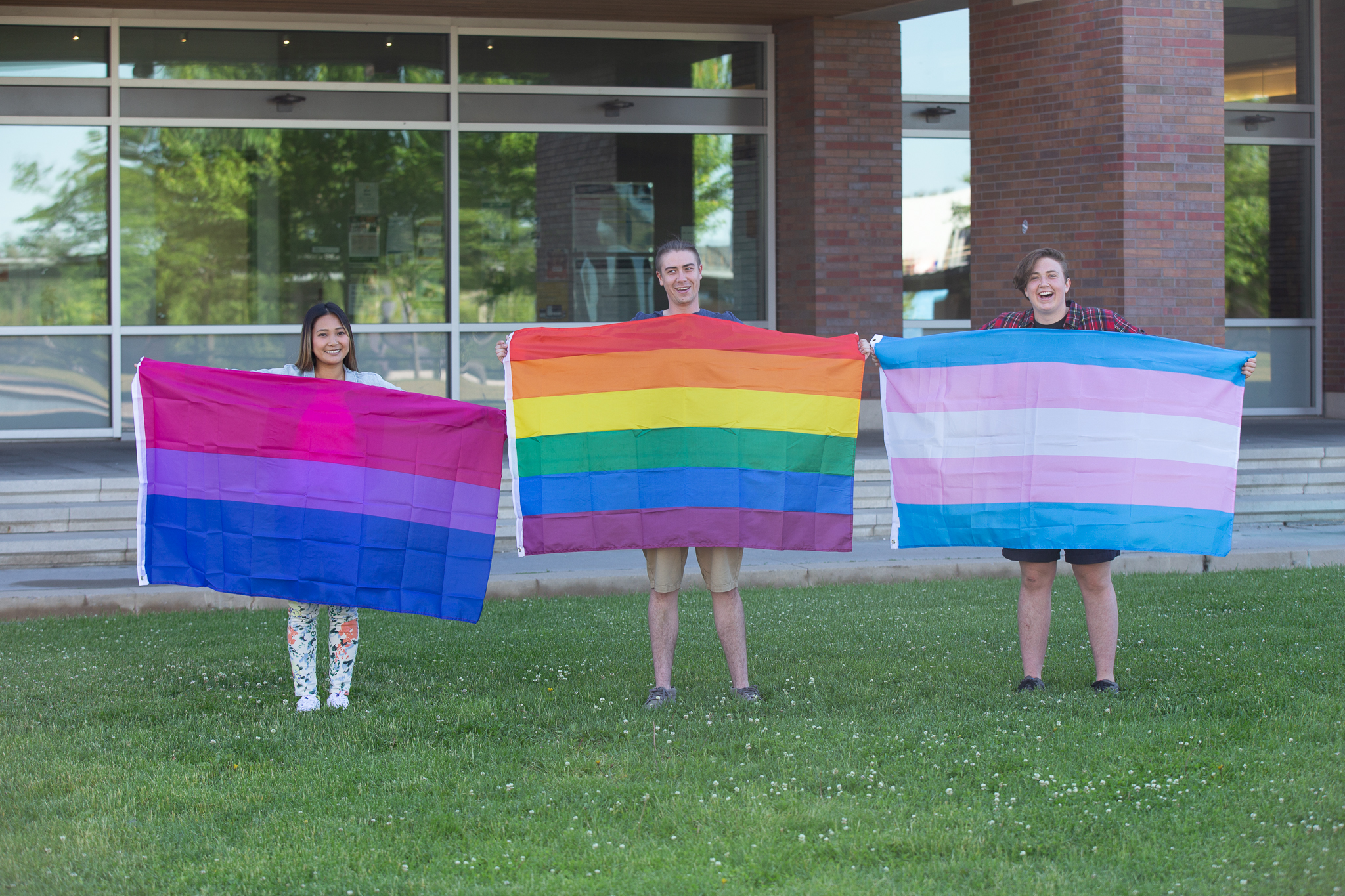 Students holding the pride flag