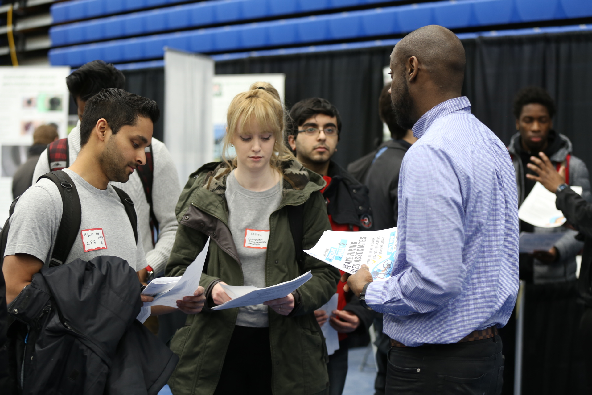 Students speaking with a representative at the career fair