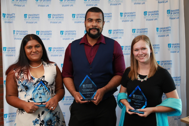 Students holding their Student Leadership Awards of Recognition