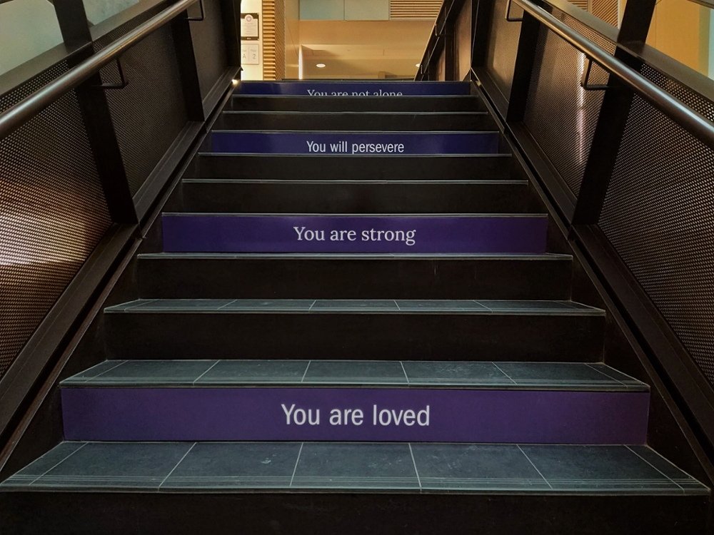 "Stairs that say ""You are loved"", ""You are strong"" and ""You will preserve"""
