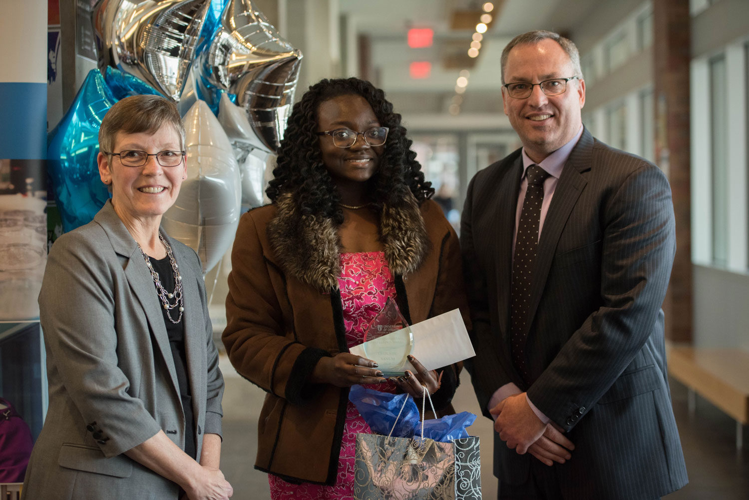 Teaching Assistant Excellence Award winner Ololade Sanusi poses with Drs Lori Livingston and Steven Murphy. ${altNumber}
