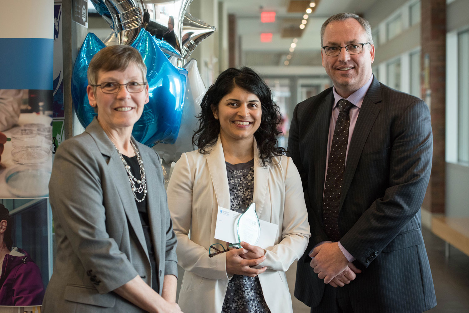 Shilpa Dogra, Teaching Innovation Award winner, poses with Drs Lori Livingston and Steven Murphy. ${altNumber}