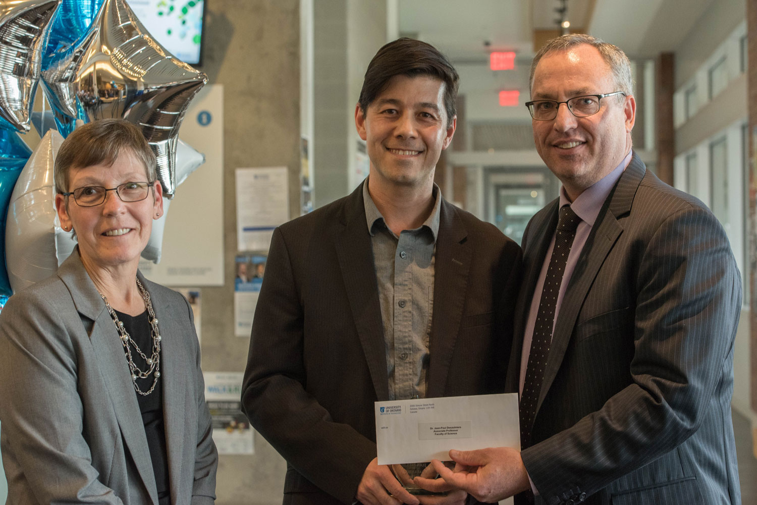 Award for Excellence in Teaching winner Jean-Paul Desaulniers poses with Drs Lori Livingston and Steven Murphy. ${altNumber}