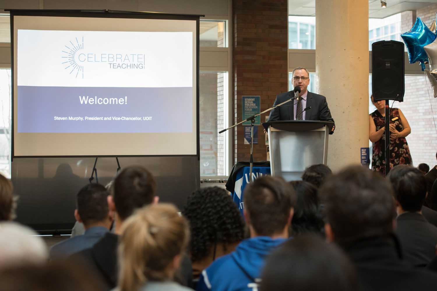 Dr Steven Murphy, President of UOIT, welcomes the audience to the ceremony. ${altNumber}