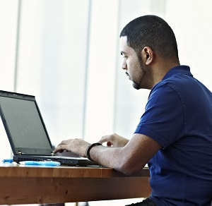 Graduate student sitting in front of laptop computer.
