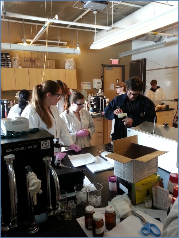 Forensic science students receiving instructions from laboratory technician Michael Allison during a forensic chemistry laboratory.