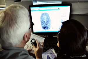 forensic science image of two people on a computer