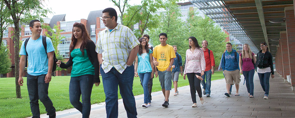 Graduate students walking at orientation