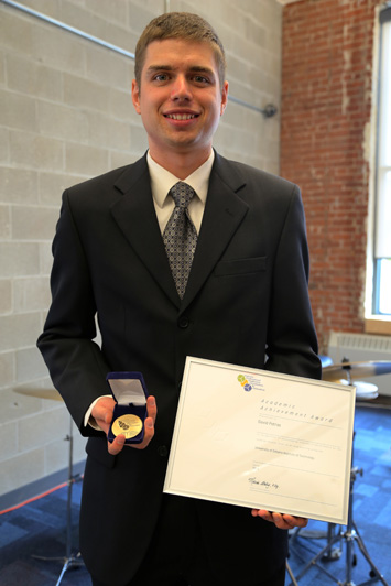 A photo of a graduate at the UOIT 2014 convocation reception